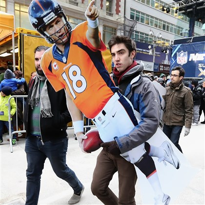 superbowl0202 Football fan Zack Poitras of Portland carries a Peyton Manning cutout while visiting Times Square Friday in anticipation of today's Super Bowl.