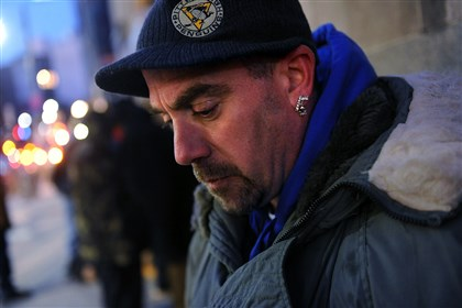 20140130rldHomeless05.1-1 Charles Riley, 43, formerly of Freeport, waits in line Wednesday to sleep at the cold-weather shelter Downtown at Smithfield Unity Church.