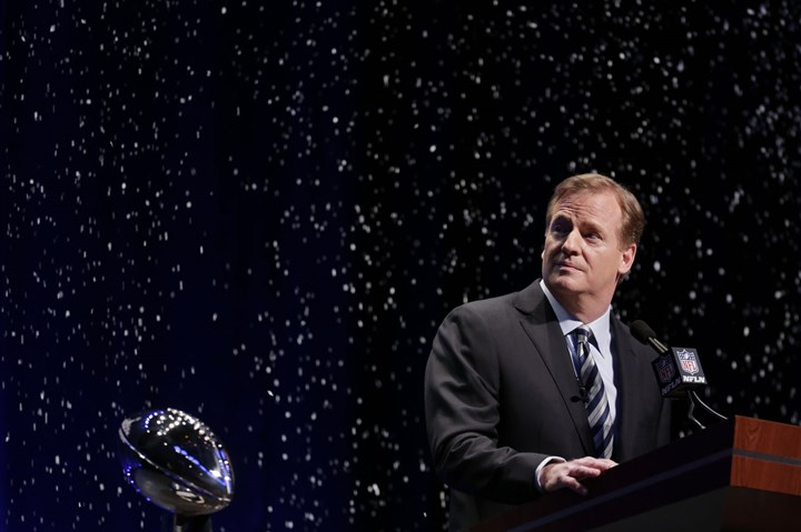 NFL comissioner Roger Goodell NFL commissioner Roger Goodell looks at artificial snow falling on stage as he speaks at a news conference Friday, Jan. 31, 2014, in New York.