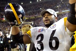 Steelers running back Jerome Bettis waves to his family at the end of the Super Bowl XL against the Seahawks.