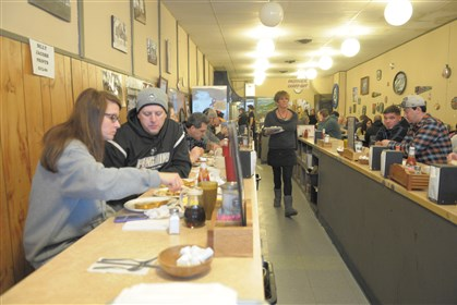 Zelie Kountry Kitchen From left, Linda and John Johns of Cranberry eat breakfast Feb. 1 at Zelie Kountry Kitchen in Zelienople as manager Karen Abramson brings an order to a customer.