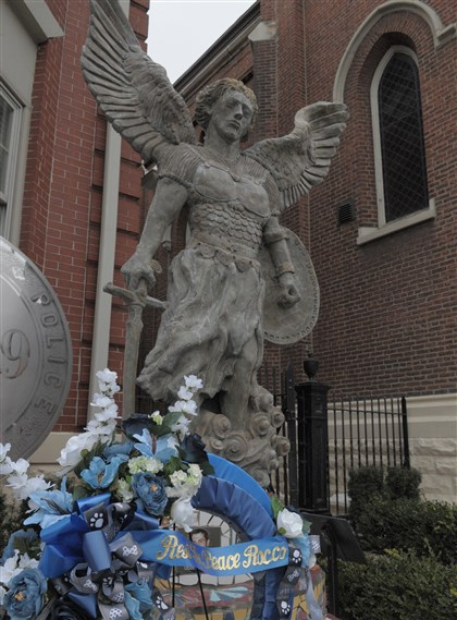 20140201ttRoccoLocal2-1 A wreath commemorating Pittsburgh police K-9 Officer Rocco has been added to the police memorial on Liberty Avenue outside St. maria Goretti Parish (formerly Immaculate Conception-St. Joseph parish) in Bloomfield.