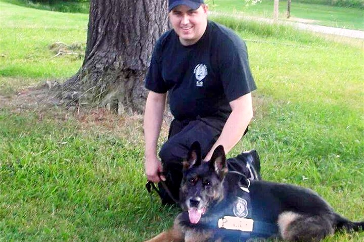 20140201RoccoLoc01-1 Rocco and his handler, Officer Phil Lerza.