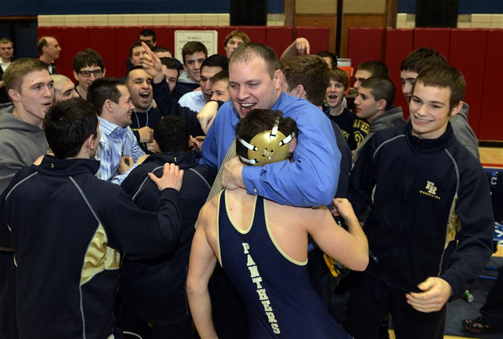 hstriple2 Franklin Regional celebrates its Class AAA team championship after defeating Greater Latrobe High School, 42-19. Head coach Eric Mausser hugs Dom Giannangeli after he won his match.