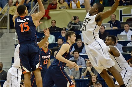 20140202mfpittsports03-2 Virginia's Malcolm Brogdon hits the winning 3-point shot as he's defended by Pitt's Lamar Patterson Sunday at Petersen Events Center.