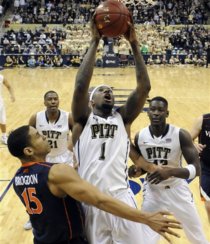Pitt's Jamel Artis Pitt's Jamel Artis drives to the net on his team's last possession of the game against Virginia's Malcolm Brogdon in the second half.