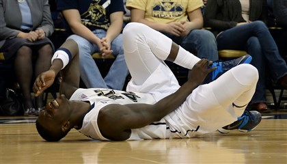 Pitt's Talib Zanna Pitt's Talib Zanna grimaces after coming down hard on his left ankle in the first half.