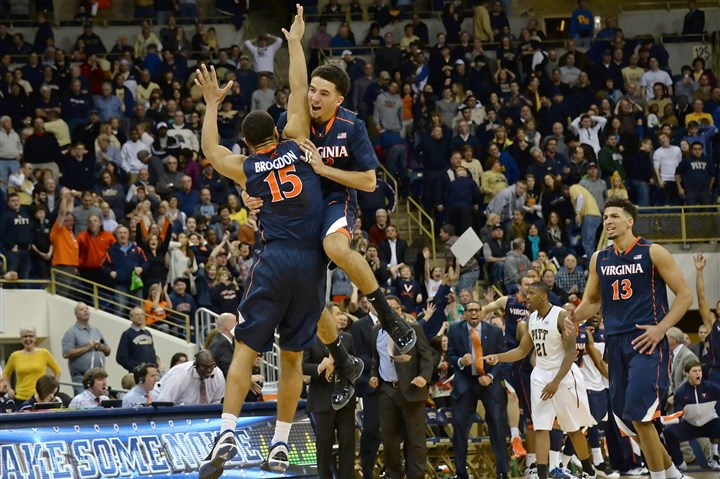 20140202mfpittsports05-4 Virginia's Malcolm Brogdon is congratulated by London Perrantes after hitting the winning 3-point shot Sunday at Petersen Events Center.