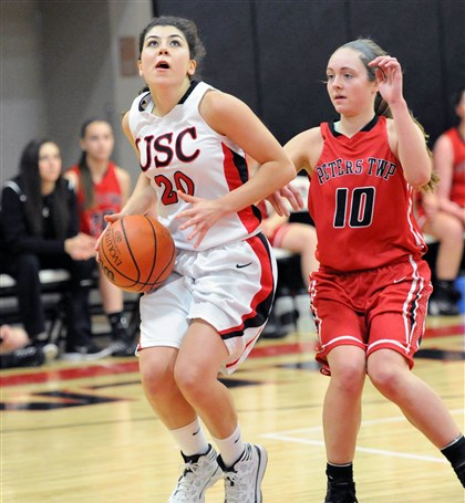 20140203JHSportsGirlsBB01 Upper St. Clair Constance Raftis looks to shoot in front of Peters Township's Alyssa Konopka. USC won, 68-52.