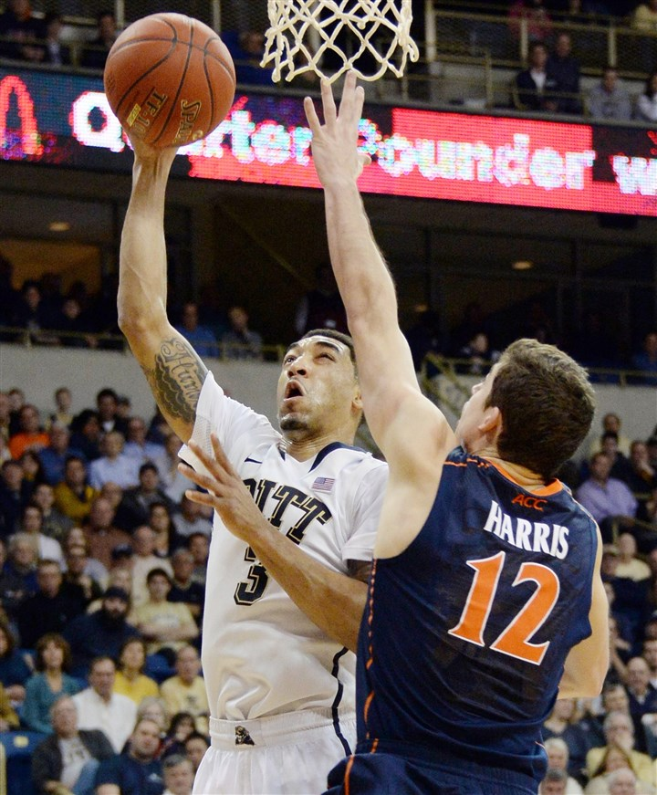 20140202mfpittsports14 Pitt's Cameron Wright drives against Virginia's Joe Harris in the second half Sunday at Petersen Events Center.
