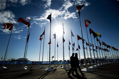 Sochi Olympics  People make their way past flags Tuesday at the site of the 2014 Sochi Winter Olympics in Sochi, Russia.