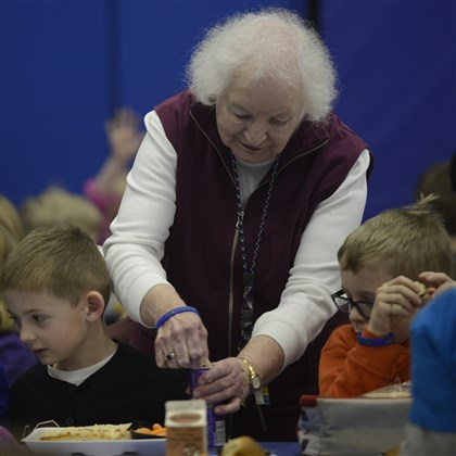 Pat Wassemann 01 Pat Wassemann, 82, helps Matthew Grisez, 7, and Cody Roberts, 7, during lunch at Memorial Elementary School in Bethel Park.