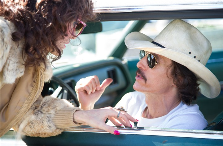 "DallasBuyersClubDVD1-5 Jared Leto as Rayon and Matthew McConaughey as Ron Woodroof in ""Dallas Buyers Club."""