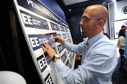 Penn State coach James Franklin places the name of quarterback recruit Michael O'Connor on a board during national signing day Feb. 5, 2014.