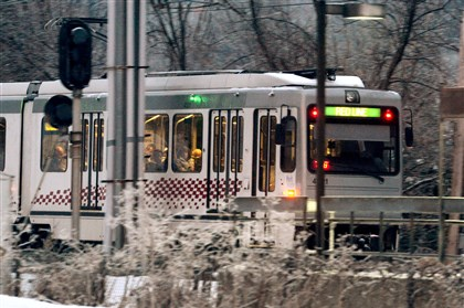 Red Line T in the winter Commuters ride on the Red Line LRT past the Dorchester stop in Bethel Park on Wednesday.