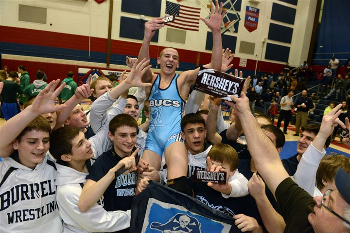 Burrell wrestling team celebrates The Burrell High School team celebrates its WPIAL Class AA championship as they defeat South Fayette High School 34-28, with help in a final match victory by Jason Roberts, center.