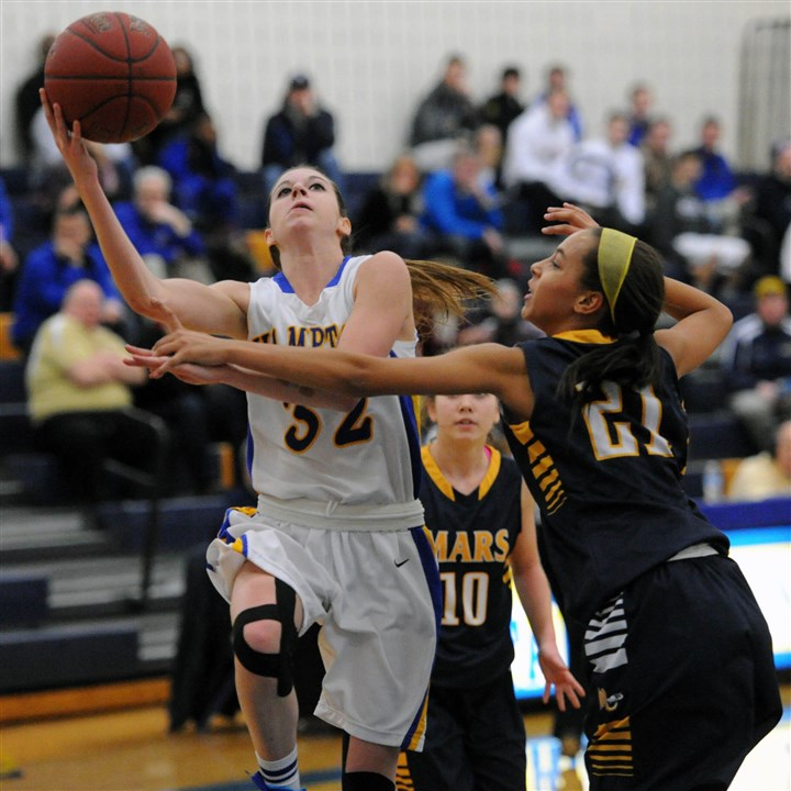 20140130JHSportsHoops03.jpg Hampton's Maddy Nelligan, left, drives to the basket and is fouled by Mars' Nicole McCloud during a Section 1-AAA game last Thursday at Hampton. The Talbots defeated the Planets, 34-26.