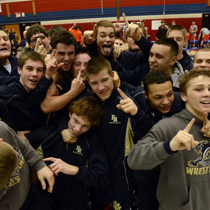 20140201bwA01AAAFRZspts01 Members of the Franklin Regional wrestling team celebrate their WPIAL Class AAA team championship after they defeated Greater Latrobe, 42-19, last Saturday at Chartiers Valley.