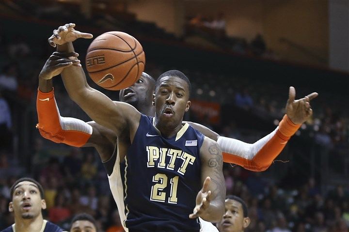 Miami's Jekiri vs. Pitt's Patterson Miami's Tonye Jekiri knocks the ball away from Pitt's Lamar Patterson Feb. 5. in Coral Gables, Fla. Pitt won 59-55 in overtime. (AP Photo/J Pat Carter)