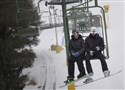 Lauren Kelly and Logan Krause, both 18, of Apollo, ride the double chairlift Feb. 5 at Boyce Park.