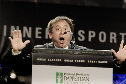 20140206bwDapperSpts08cc Dr. Freddie Fu imitates Pitt basketball coach Jamie Dixon, who would introduce Mark Nordenberg, Chancellor of the University of Pittsburgh, who is getting the Dr. Freddie Fu Sports Leadership Award at the 78th Annual Dapper Dan Dinner & Sports Auction.