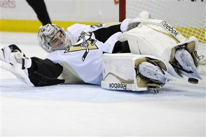 Penguins-Sabres Hockey Penguins goaltender Marc-Andre Fleury dives across the goal crease to make a save during a game against Buffalo earlier this season.