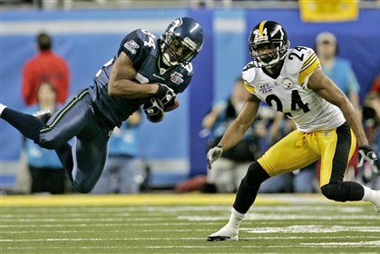 Super Bowl, Bobby Engram and Ike Taylor During 2006's Super Bowl XL in Detroit, Bobby Engram of the Seattle Seahawks catches a 10-yard pass in front of the Steelers' Ike Taylor. Engram, who joined the Pitt staff in 2012, has taken a job with the Baltimore Ravens.