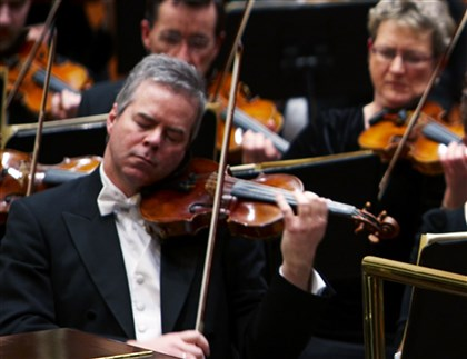 Violin Theft Milwaukee In this undated photo provided by the Milwaukee Symphony Orchestra concertmaster Frank Almond plays a 300-year-old Stradivarius violin that was on loan to him during a concert in Milwaukee. Police said three people have been arrested in connection with the theft of the multi-million-dollar instrument.