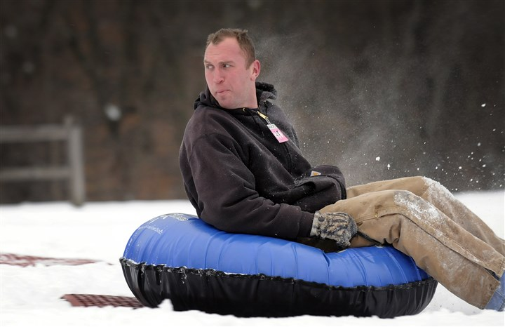 20140205jrBoyceLocal3-2 Mark Winters, of Etna tries some snow tubing Wednesday at Boyce Park in Plum.