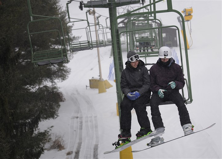 20140205jrBoyceLocal4-3 Lauren Kelly, 18, and her boyfriend Logan Krause, 18, both of Apollo, Pa., ride the ski lift Wednesday at Boyce Park in Plum.