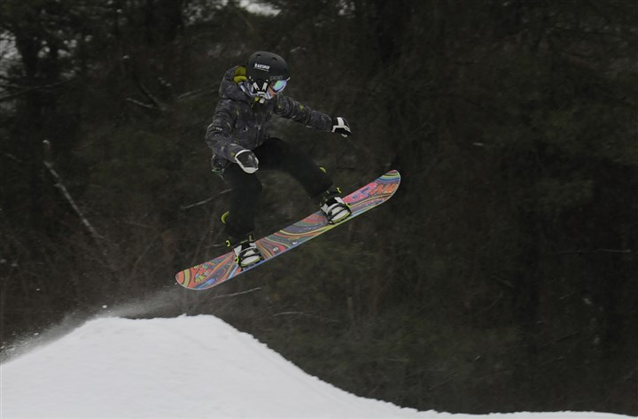 20140205jrBoyceLocal6-5 Mark Peterman, 15, of Plum flies over one of the downhill features Wednesday at Boyce Park in Plum.