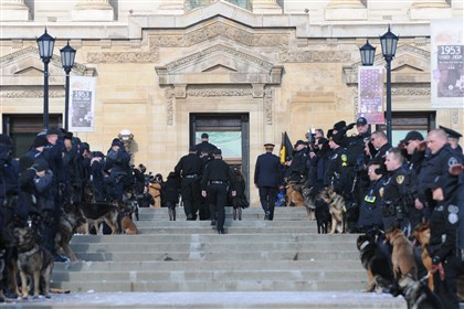 Rocco funeral, Officers salute Phil Lerza Police officers with their K-9 partners salute officer Phil Lerza as he enters the memorial service for his fallen partner, Rocco, at the Soldiers & Sailors Memorial Hall and Museum in Oakland.