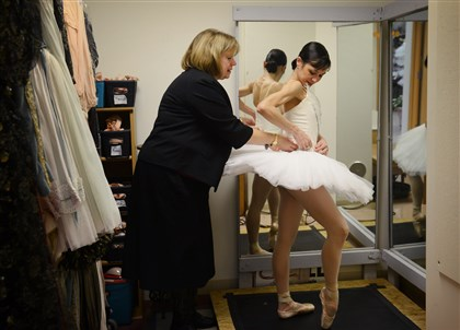 "SwanLake Pittsburgh Ballet Theatre costumier Janet Groom Campbell fits dancer Christine Schwaner for her Swan Queen costume for the upcoming production of ""Swan Lake."""