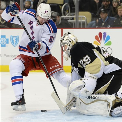 20140207pdPenguinsSports02 Penguins goalie Marc-Andre Fleury makes save on the Rangers left winger Rick Nash in the second period at the Consol Energy Center.