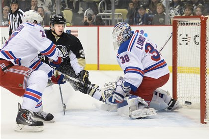 Olli scores Olli Maatta pushes the puck past Rangers goalie Henrik Lundqvist in the first period of a game last week at the Consol Energy Center.