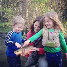 20140207hoamidea3spts There's nothing particularly masculine about fly fishing, says instructor Amidea Daniel, pictured on Fishing Creek with her son Logan, 3, daughter Evangeline, 5, and a nice brown trout.