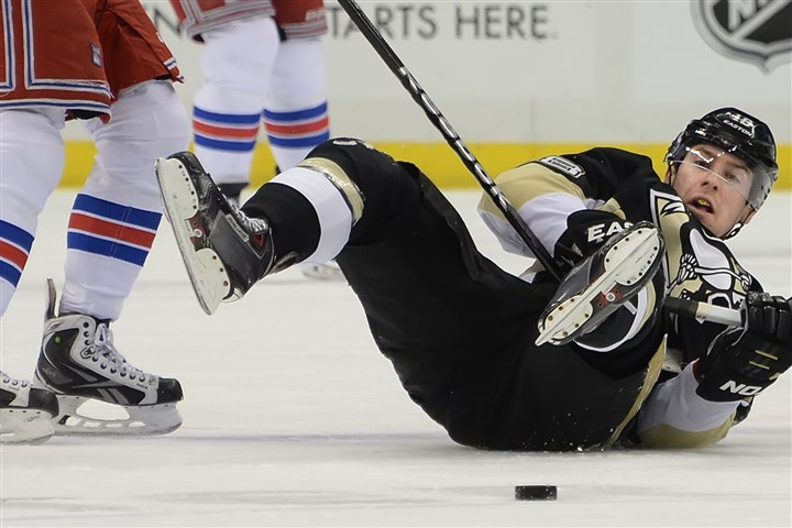 20140207pdPenguinsSports03-1 Rangers left winger Carl Hagelin trips up Penguins left winger James Neal.