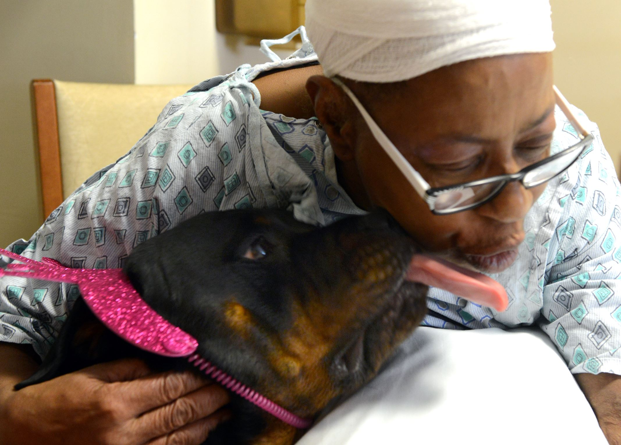 Josie Josie gives a kiss to patient Anita Reid of East Pittsburgh at UPMC Montefiore.