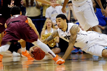20140208ppPittVaTech4SPORTS-3 Pitt guard Cameron Wright grabs a loose ball from Virginia Tech guard Devin Wilson during Pitt's overtime win at Petersen Events Center.