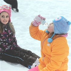 Snow shovel 3 Jamison Frantz, 7, of Conway, drinks water, while Kelli Kovalick, 8, of Butler, waits.