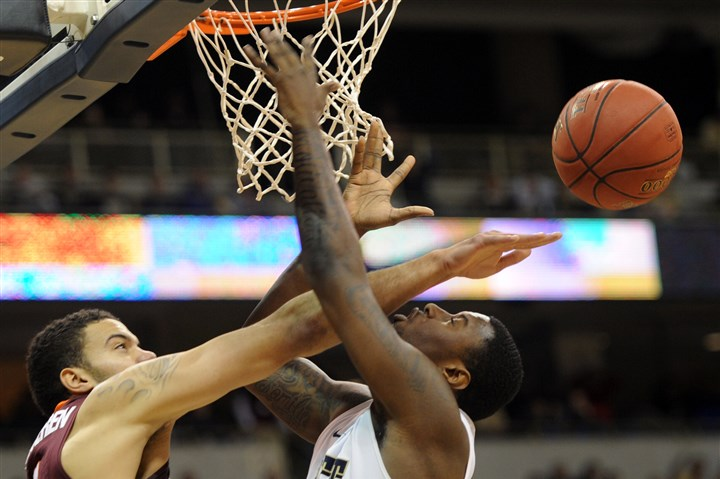 20140208ppPittVaTech1SPORTS Pitt forward Jamel Artis is fouled by Virginia Tech forward Joey Van Zegeren.