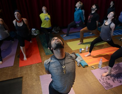 20140209jrYogaLocal1 Hunter Howell, 41, of Stanton Heights practices yoga during the third annual Pittsburgh Yoga Expo.