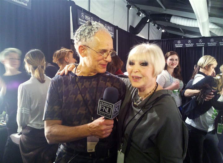 At Fashion Week Philip Pelusi, left, and Venexiana designer Kati Stern do an interview for Fashion News Live backstage on Saturday at Mercedes-Benz Fashion Week at Lincoln Center in New York.