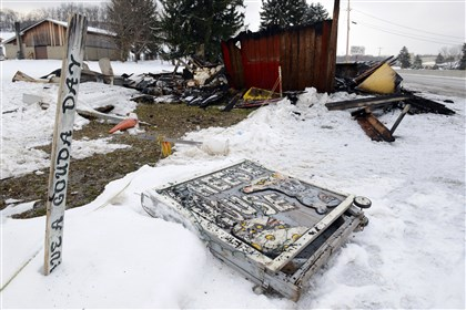 20140210dsCheeseHouseLoc02 A damaged sign rests in the snow Monday near the burned remains of the Cheese House along Route 22 in Derry Township, Westmoreland County. The fire started about 11 p.m. Sunday.