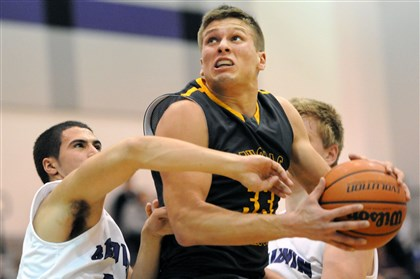 20140210JHSportsBoysBB02-1 Thomas Jefferson's Chase Winovich goes back up for a shot after grabbing a rebound over Baldwin's Doug Altavilla, left, Monday at Baldwin. Thomas Jefferson won, 64-41.