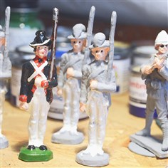 Toy soldiers Toy soldiers is varying stages of painting on David Frankowski's work bench.