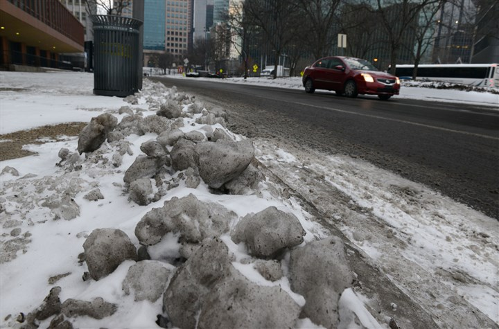 Frozen slush Mounds on frozen slush remain piled on Monday morning along Liberty Avenue in Gateway Center.