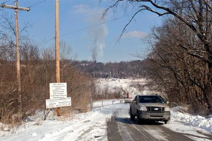 20140211mbgaswellscene02.jpg Smoke clearly can be seen in the distance from this morning's gas well explosion near Bobtown.