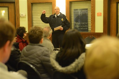 20140211rldPublicSafety02-1 Zone 5 Cmdr. Tim O'Connor speaks at a public safety meeting Tuesday at the Union Project in Highland Park, urging residents to be vigilant and report any unusual activity in the wake of the killing of the Wolfe sisters.