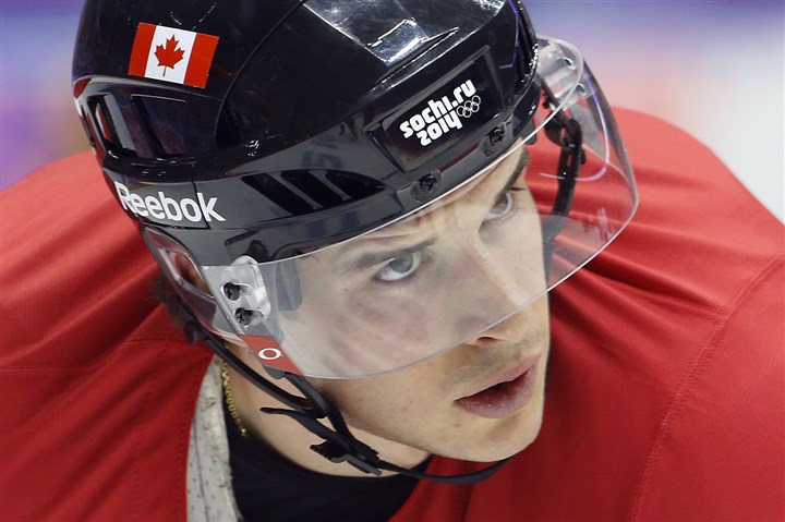 Sidney Crosby  Canada forward Sidney Crosby waits for a pass during a training session at the 2014 Winter Olympics, Monday, Feb. 10, 2014, in Sochi, Russia.